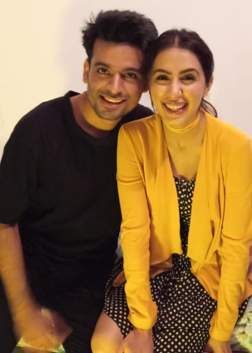 Swati Kapoor smiling for a picture alongside Anuj Sikri in December 2018