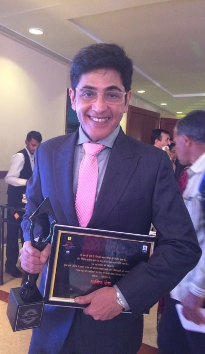 Aasif Sheikh smiling for a picture in March 2018