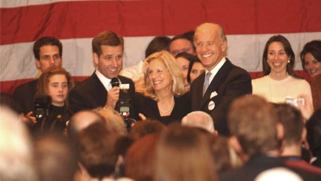 Beau Biden pictured while giving his victory speech as Delaware's newly-elected Attorney General on November 7, 2006, as Jill Biden, Joe Biden, and the Biden family look on