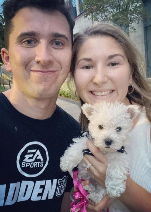Brett Barrett as seen in a picture that was taken with his wife Maddy and their dog Heidi in September 2020