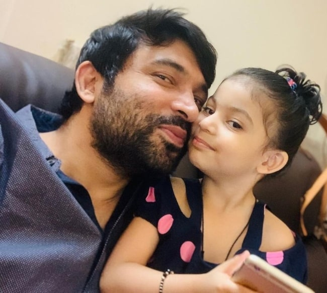 Chandan Prabhakar as seen while taking a selfie with his daughter in March 2020