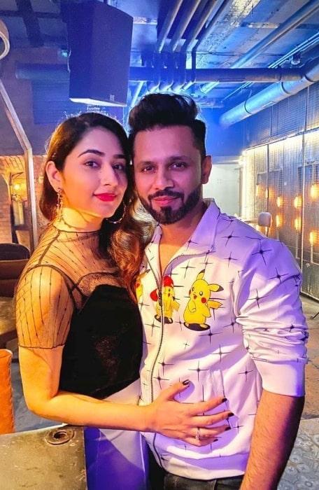 Disha Parmar posing for the camera alongside Rahul Vaidya