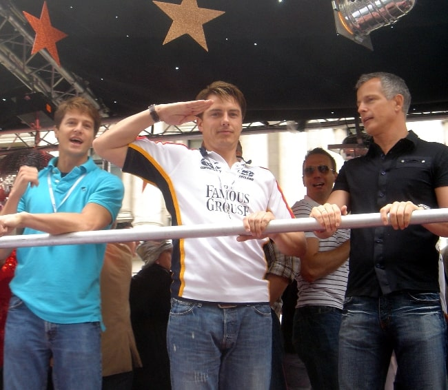 From Left to Right - Scott Gill, John Barrowman (saluting in the style of Captain Jack Harkness), and politician Brian Paddick on a float at the 2007 London Gay Pride