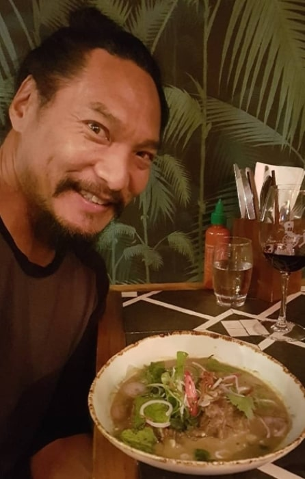 Jason Scott Lee taking a selfie with his food in November 2018