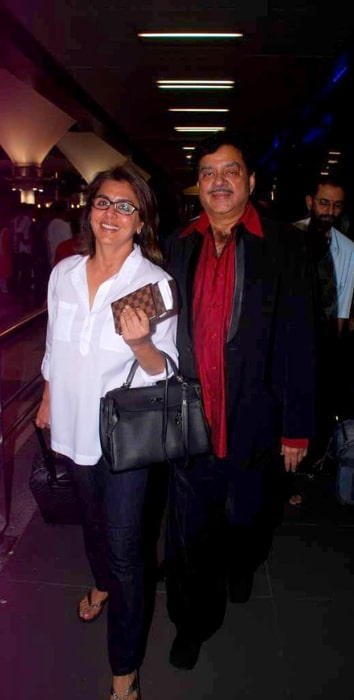 Neetu Singh and Shatrughan Sinha returning from IIFA 2012