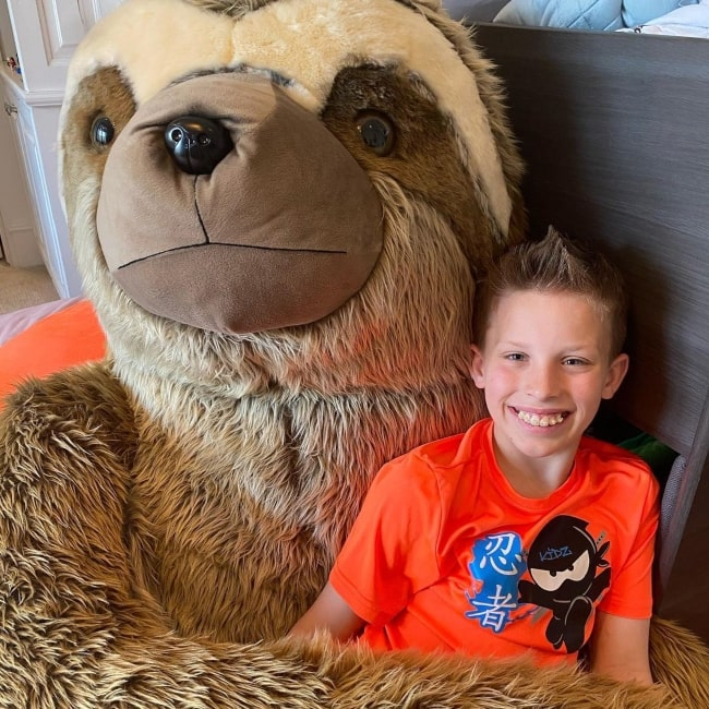 Paxton Myler as seen in a picture with a large sloth soft toy April 2020