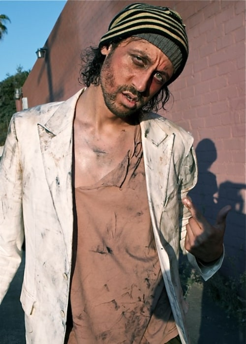 Santino Rice playing the role of a homeless man in the adult film L.A. Zombie in 2010