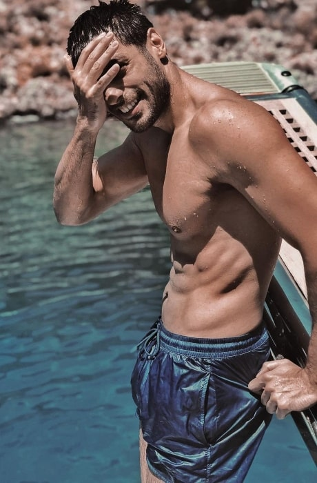 Serkan Çayoğlu as seen while posing shirtless for the camera in August 2020