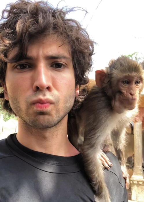 Adam G. Sevani having a good time with a friend in September 2018