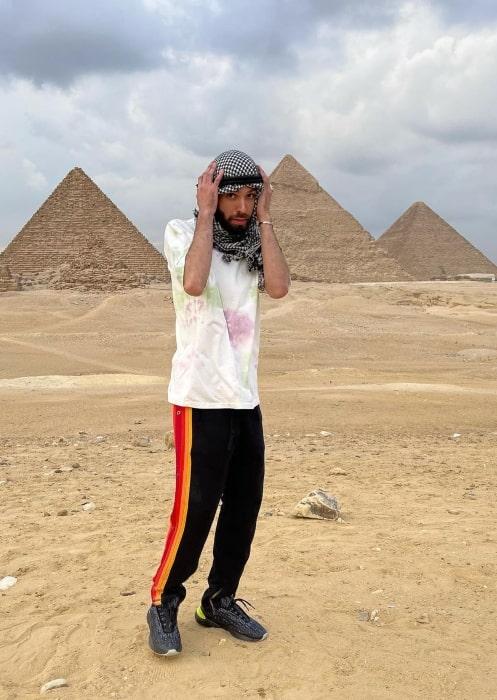 Adam G. Sevani posing in front of the pyramids in December 2020
