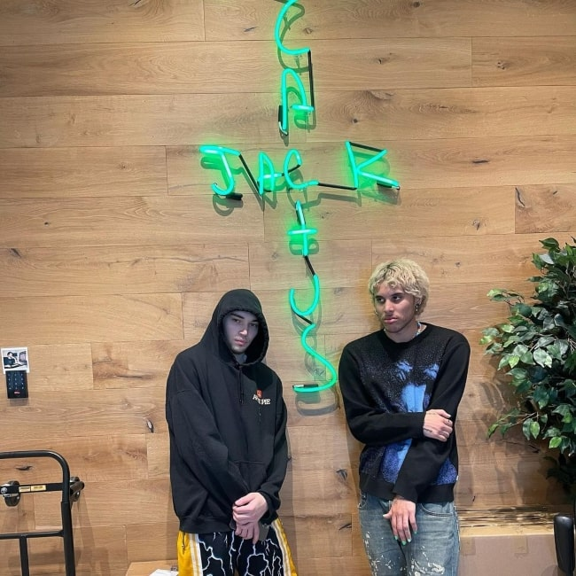 Adin Ross as seen in a picture that was taken with content creator Ray in front of a Cactus Jack sign in February 2021