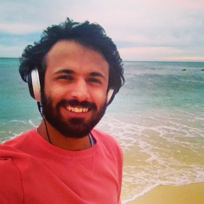 Advait Chandan smiling for a picture at Bronte Beach in August 2013