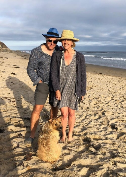 Brooke Smith and her husband Steve Lubensky as seen in a picture with their dog on the beach in June 2020