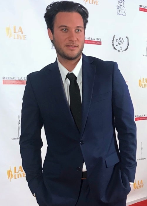 Bryce Hirschberg in a picture that was taken on on the red carpet at the LA Live premiere of Counterfeiters on November 11, 2017