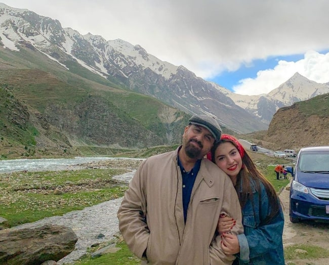Dananeer Mobeen smiling in a picture alongside her father
