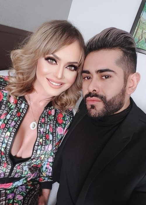 Gabriela Spanic smiling for a picture alongside Miguel Sanroman Rubio in January 2021