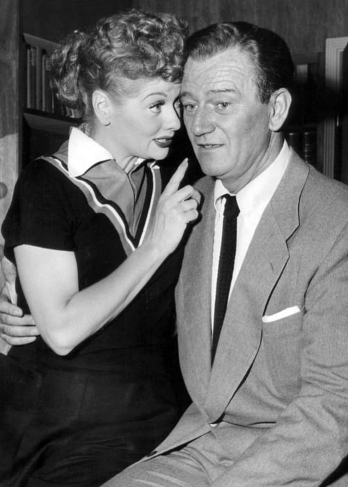 John Wayne and Lucille Ball in a publicity photo from the television program 'I Love Lucy'