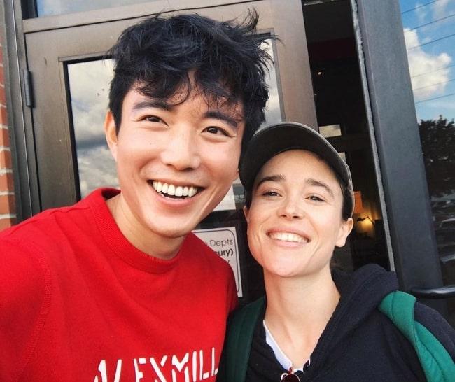 Justin H. Min (Left) smiling in a selfie alongside Elliot Page in Toronto, Ontario in September 2019