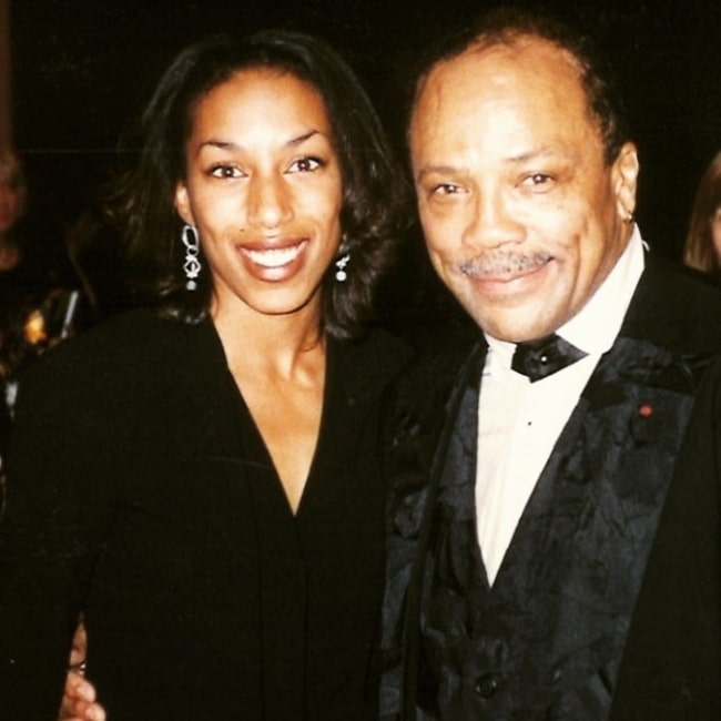 Kim Hill as seen in a picture with legendary singer, songwriter, and record producer Quincy Jones in possibly 1994