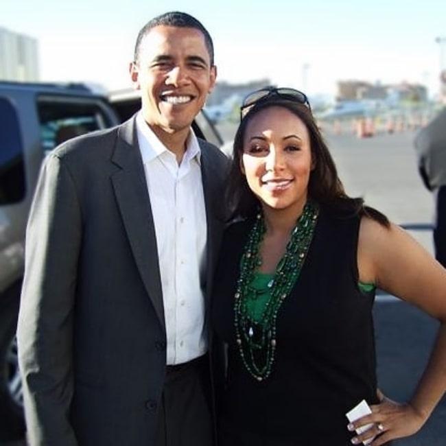 Mara Schiavocampo posing for a picture alongside Barack Obama