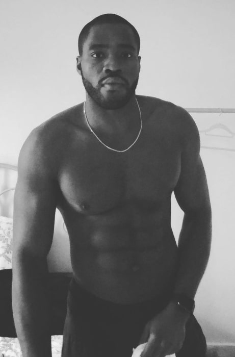 Martins Imhangbe as seen while posing shirtless for the camera in February 2021