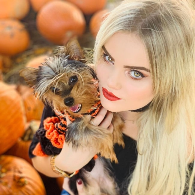 Mia Diaz as seen in a picture that was taken with her Yorkshire Terrier name Lolo in October 2019, in Central Presbyterian Church