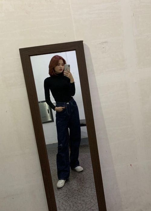 Rina as seen taking a mirror selfie in November 2020