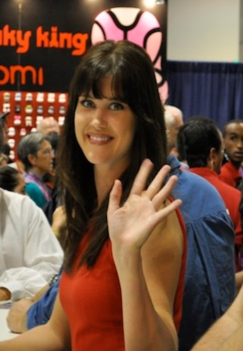 Sarah Lancaster as seen while smiling for the camera at Comic Con 2010