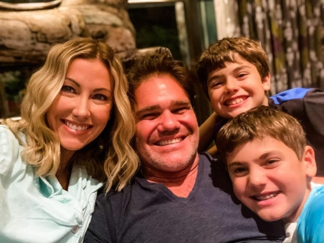 Stephanie Hollman spending a pajamas, Christmas movies and hot chocolate kind of night with her family in December 2020