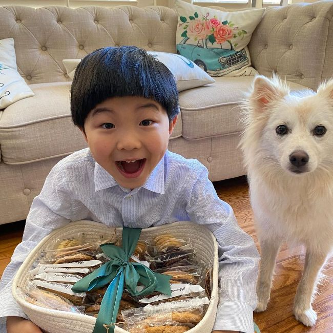 Alan S. Kim as seen smiling with his dog in 2021