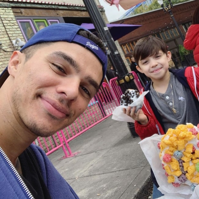 Andrew Jacobs enjoying original Voodoo Doughnuts with his son in September 2019