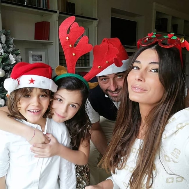 Barbara Chiappini as seen in a selfie with her husband Carlo Marini Agostini and children Sveva Lucia and Folco in December 2020