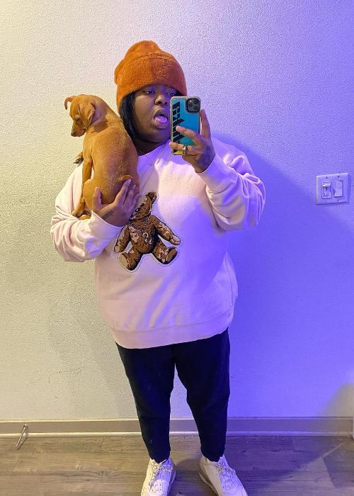 Chika as seen taking a selfie with her dog in 2020