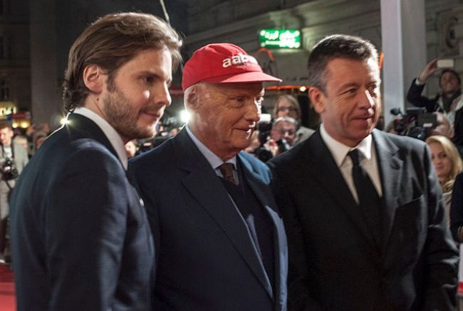 (From left to right) Daniel Brühl, Niki Lauda, and Peter Morgan as seen in 2013