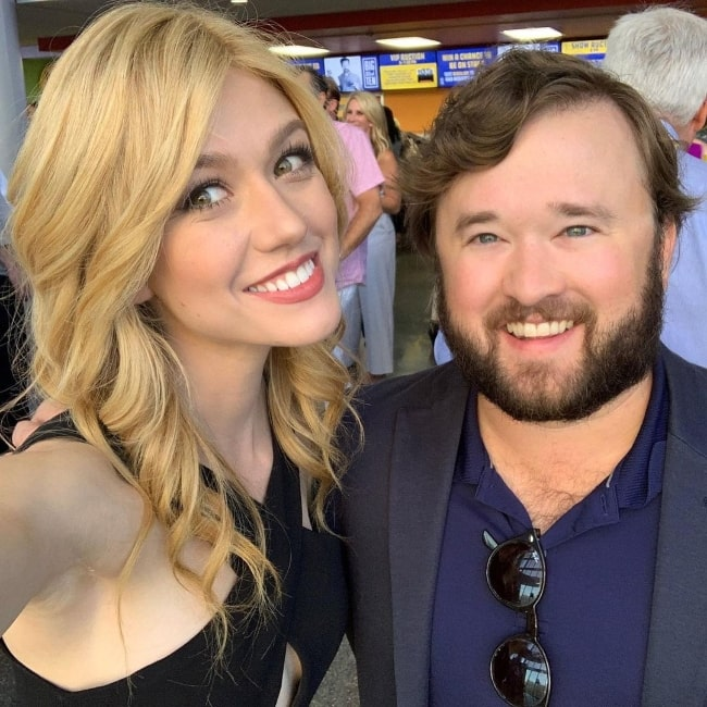 Haley Joel Osment smiling in a selfie alongside Katherine McNamara in Kansas City, Missouri in June 2019