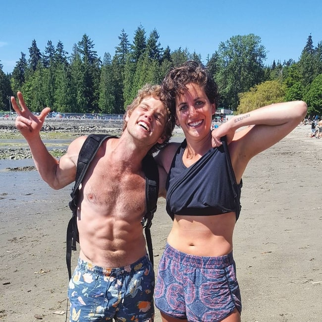 Jedidiah Goodacre (Left) posing shirtless for a picture along with Jess Smith at English Bay in Vancouver, British Columbia, Canada, in July 2017