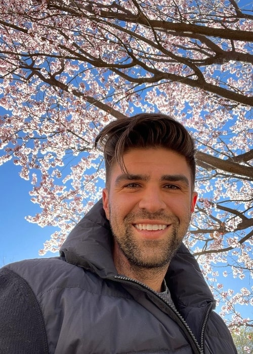 Justin Mikita smiling in a selfie at Los Poblanos Historic Inn & Organic Farm in March 2021