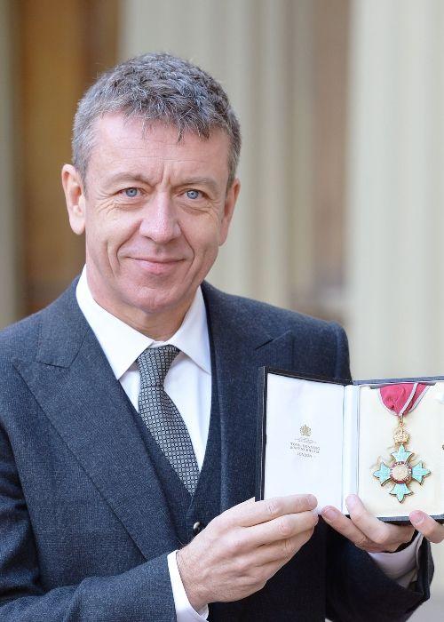 Peter Morgan as seen posing with his CBE award in 2016