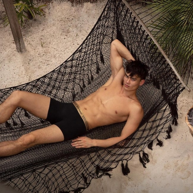 Simonas Pham as seen in a shirtless picture that was taken in Tulum, Mexico in February 2021