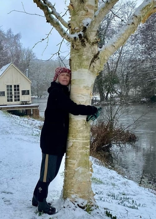 Trudie Styler pictured while hugging a tree in in January 2021
