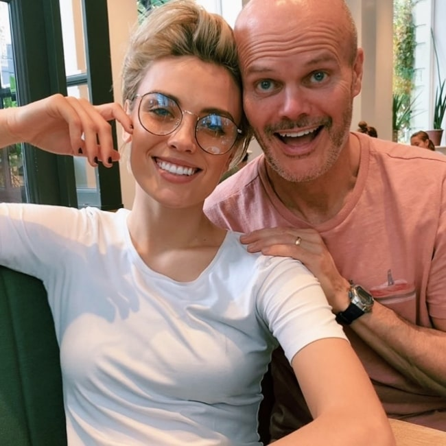 Wallis Day smiling in a picture alongside her father in London, United Kingdom