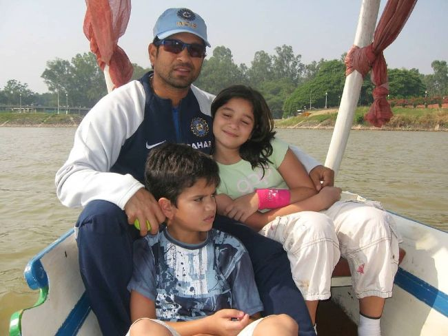 A young Arjun as seen with his father and sister