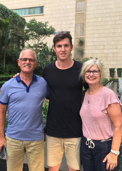 Adam Milne with his parents, as seen in April 2017