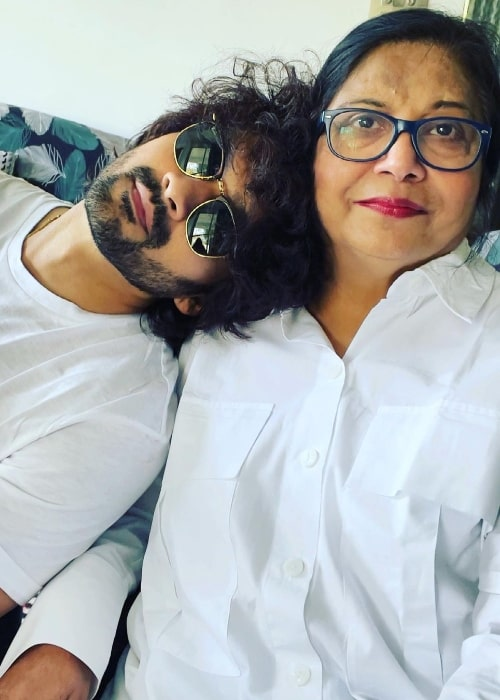 Aditya Redij posing for a picture with his mother