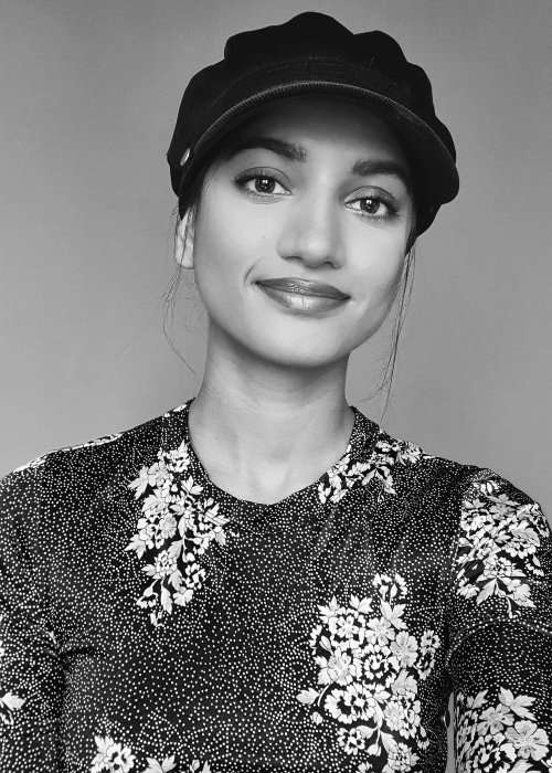 Amita Suman smiling for a picture in April 2021
