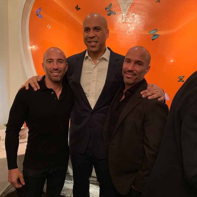 Brett Oppenheim as seen in a picture with his brother Jason Oppenheim and United States Senator Cory February 2019