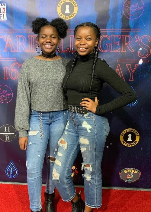 Bria Danielle Singleton (Left) and her sister Brooke smiling for the camera