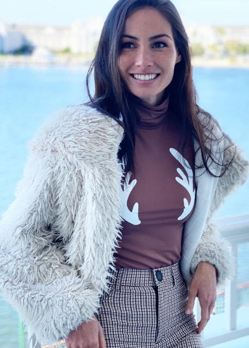 Caitlin McHugh as seen while smiling for the camera at Disney's Boardwalk Resort in December 2019