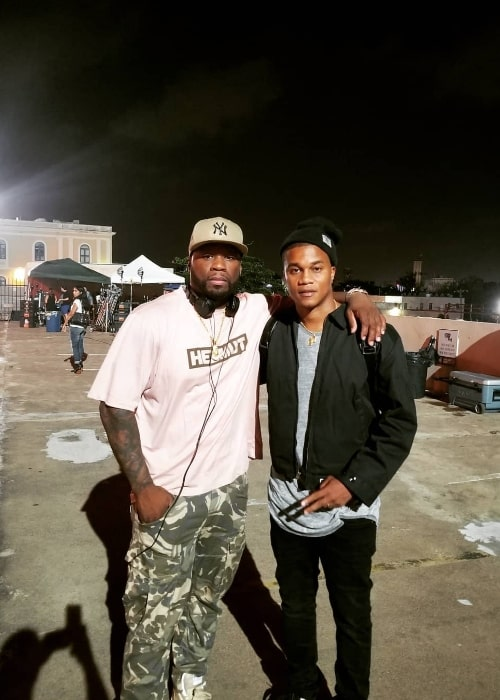 Cory Hardrict (Right) posing for a picture alongside 50 Cent in San Juan, Puerto Rico in August 2018