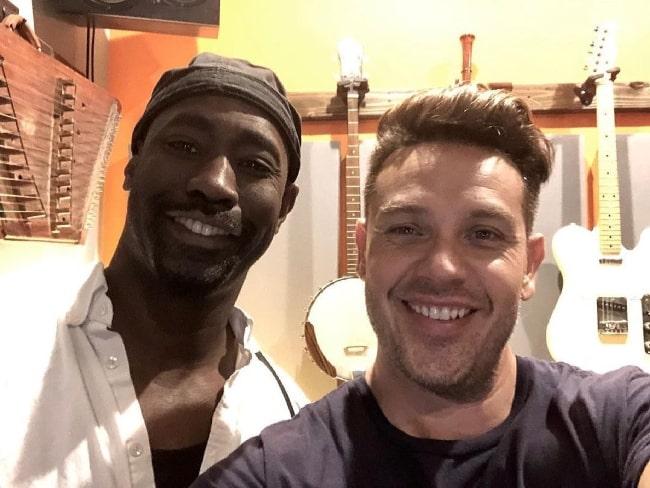 D. B. Woodside (Left) smiling in a selfie alongside Kevin M Alejandro